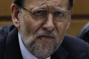 Spain's Prime Minister Mariano Rajoy listens the debate during a Spanish Parliament session in Madrid, Spain, Thursday, Aug. 1, 2013. Rajoy brushed off demands he should resign after text messages emerged showing him comforting a former political party treasurer under investigation over a slush fund and secret Swiss bank accounts. The spectacle of alleged greed and corruption has enraged Spaniards hurting from austerity and sky high unemployment. (AP Photo/Andres Kudacki)