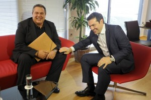 Leftist Syriza party leader and winner of the Greek general election Alexis Tsipras (R) meets with leader of right-wing Independent Greeks party Panos Kammenos at his office at the party's headquarters in Athens, Greece, September 21, 2015. Greece's Independent Greeks party said on Sunday it would ally with election winners Syriza to form a coalition government. REUTERS/Michalis Karagiannis
